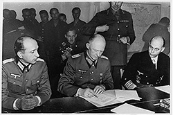 Colonel General Alfred Jodl signs the Instrument of Surrender