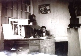 Lawrence behind a large desk in corner of Alston's studio 306. National Archives, Harmon Foundation