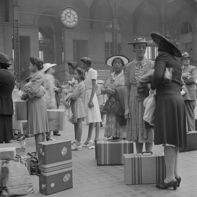 New York, New York. Waiting for the trains at the Pennsylvania railroad station.