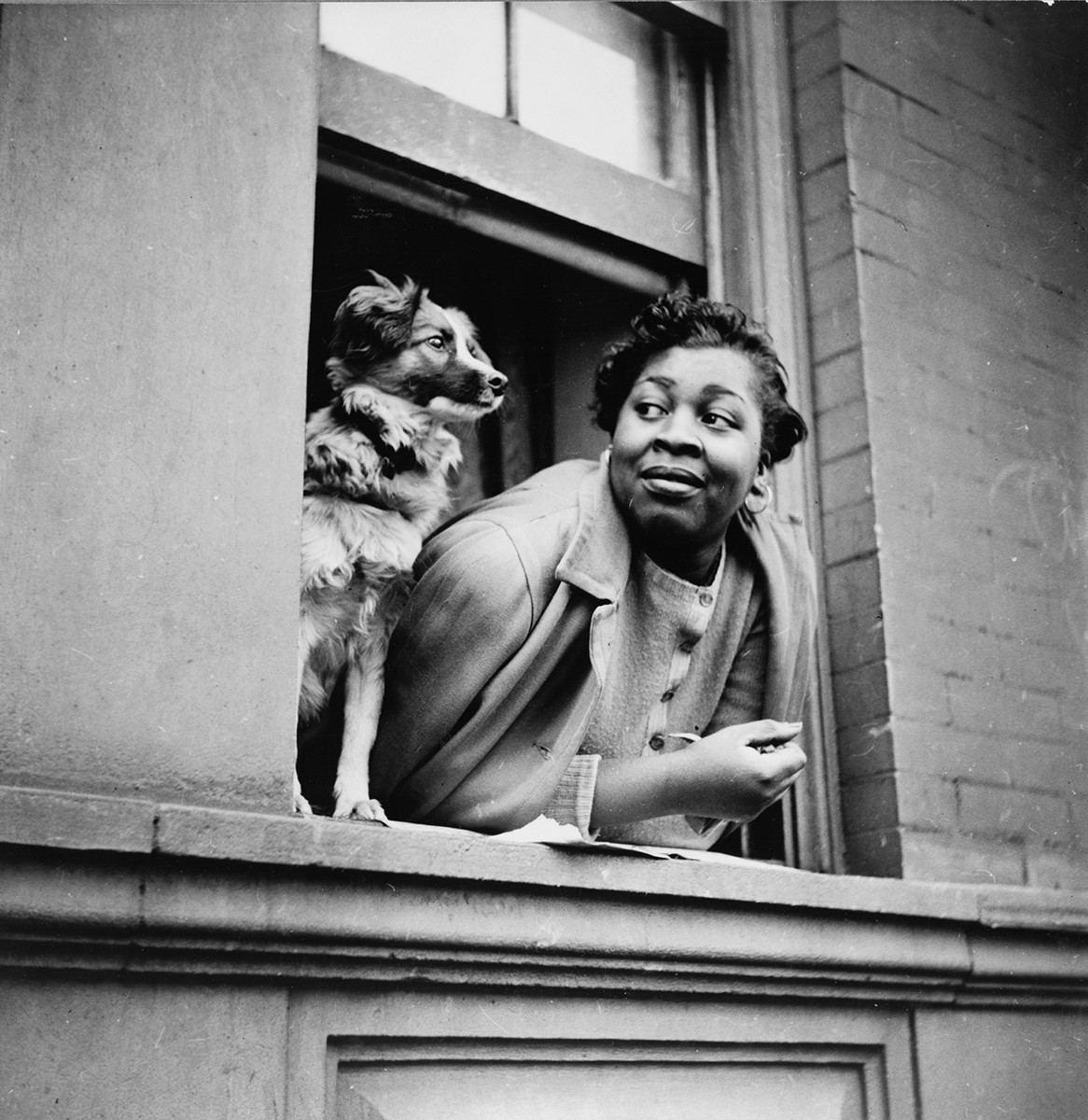 Gordon Parks, New York, New York. A woman and her dog in the Harlem section, 1943