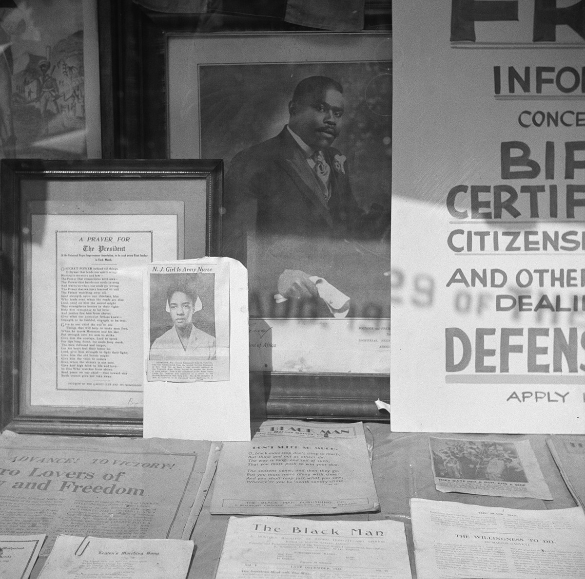 Gordon Parks, Signs in the windows of a Marcus Garvey club in the Harlem area, 1943